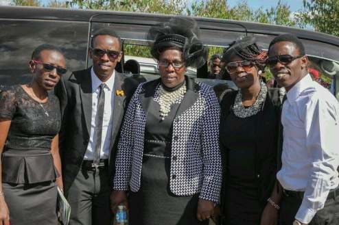 Gerriey with his mother and his siblings on the day that his father was laid to rest; a week before Gerriey traveled to the United States for the first time.